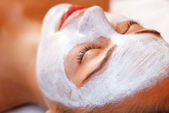 Attractive woman having mask in spa salon Royalty Free Stock Photo