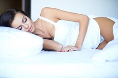 Attractive woman having a restful sleep Royalty Free Stock Images