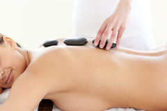 Attractive woman having a stone treatment Royalty Free Stock Image
