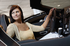 Attractive woman having a test drive Stock Photography