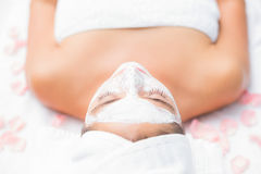 Attractive woman having white cream on her face at spa center Royalty Free Stock Photos