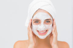 Attractive woman having white cream on her face at spa center Royalty Free Stock Images