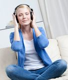 Attractive woman in headphones listens to music Royalty Free Stock Photo