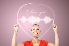 Attractive woman with heart graphics Stock Images