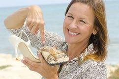Attractive woman between Heels and Health Stock Photo