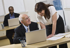 Attractive woman helping older man. Stock Photos