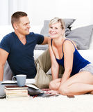 Attractive woman and her boy friend in the living room talking. Stock Images