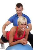 Attractive woman with her fitness coach Stock Photography