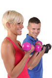 Attractive woman with her fitness trainner Royalty Free Stock Photos