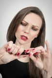 Attractive woman and her lipstick Royalty Free Stock Photo