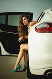 Attractive woman in high heel shoes get out the car Stock Photography