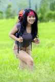 Attractive woman hiking to mountain peak Royalty Free Stock Photo