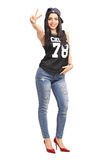 Attractive woman in hip-hop clothes making a hand sign Stock Photo
