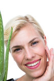 Attractive woman holding aloe vera plant Royalty Free Stock Photos