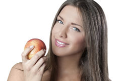 Attractive woman holding an apple. Isolated on white background stock photos
