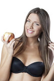 Attractive woman, holding an apple Royalty Free Stock Photography