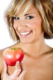 Attractive woman holding an apple. Promoting healthy lifestyle stock photo