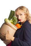 Attractive woman holding a bag of useful food Royalty Free Stock Photos