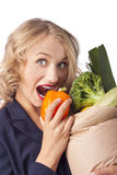 Attractive woman holding a bag of useful food Royalty Free Stock Photo