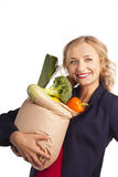 Attractive woman holding a bag of useful food Stock Images