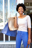 Attractive woman holding bags outside mall Stock Photography