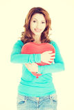 Attractive woman holding a baloon heart. Royalty Free Stock Image