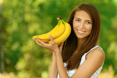 Attractive woman holding bananas Royalty Free Stock Photography