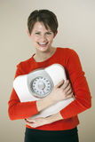Attractive Woman Holding a Bathroom Scale Stock Images