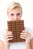 Attractive woman holding big bar of chocolate Stock Images