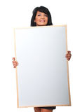 Attractive woman holding big blank banner royalty free stock photo
