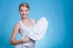 Attractive woman holding big white towel royalty free stock photos