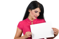 Attractive woman holding a blank page. Attractive brunette woman holding a blank page and looking at copy space  isolated on white background,check also People Stock Photo