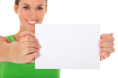 Attractive woman holding blank sgin. Attractive young woman holding blank sign. All on white background. Selective focus on sign in foreground Stock Photography