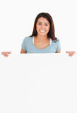 Attractive woman holding a  board Royalty Free Stock Photo