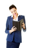 Attractive woman holding a book. Stock Image