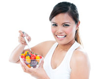 Attractive Woman Holding A Bowl Of Fruits Stock Image
