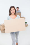 Attractive woman holding boxes in her new house Royalty Free Stock Photo