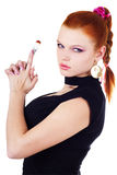 Attractive woman holding brush. Isolated on white Royalty Free Stock Photo