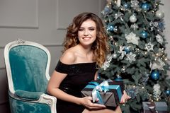 Attractive woman holding a Christmas gift Royalty Free Stock Photography