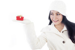 Attractive woman holding a christmas present Stock Photos
