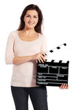 Attractive woman holding clapperboard Stock Image