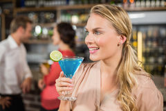 Attractive woman holding cocktail glass Royalty Free Stock Images
