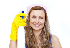 Attractive woman holding a detergent spray Royalty Free Stock Photos