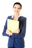Attractive woman holding files. Isolated on white Royalty Free Stock Images