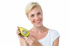 Attractive woman holding fresh avocado Royalty Free Stock Photo