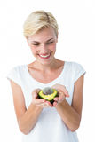Attractive woman holding fresh avocado Stock Images