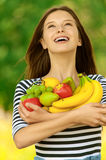 Attractive woman holding fruit Stock Photo