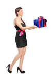 Attractive woman holding a gift Stock Image