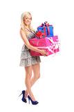 Attractive woman holding a gifts Stock Image