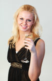 Attractive woman holding a glass of champagne Stock Photography